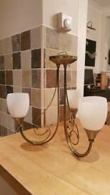 2 x brass Chandlers. 3 opaque shaded lamps on each.