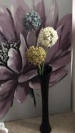 Flowers in tall glass vase