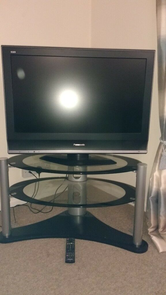 "Panasonic 32"" LCD TV (model no. TX-32LMD70A) Excellent condition and glass stand with 2 shelves."