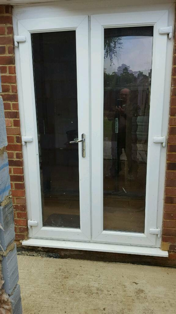 White upvc french doors in church crookham hampshire for Upvc french doors bristol