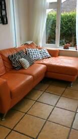 Leather corner sofa. DFS (orange)