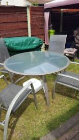 Grey Round Glass Table and Chairs and Grey Parasol