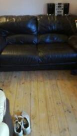 Brown leather three seater