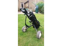 Simple golf trolley. Folds up. Takes different golf bags. Adjustable. Clubs not included.