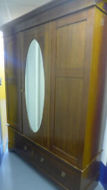 Antique English armoire wardrobe with oval bevelled mirror door