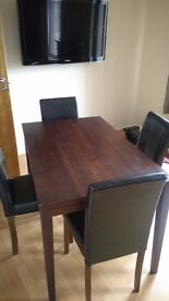 Dining table and faux leather chairs