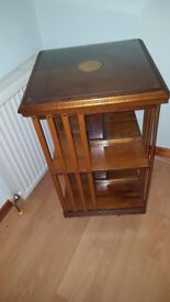 Yew wood revolving book case.