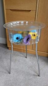Ikea Side Table. Plastic top with removable lid with tubular legs 59cm Tall, 40cm Diameter