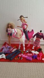 Barbie dolls , battery-operated horse and accessories