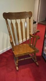 Large solid wooden rocking chair
