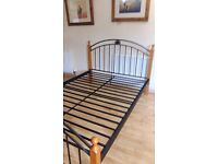 Very sturdy metal and pine bed. I can also arrange delivery if required