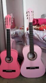 2 x pink guitars