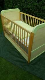 Cot bed, light wood, mint green trim
