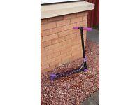 Purple stunt scooter
