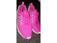 Pink Adidas trainers.