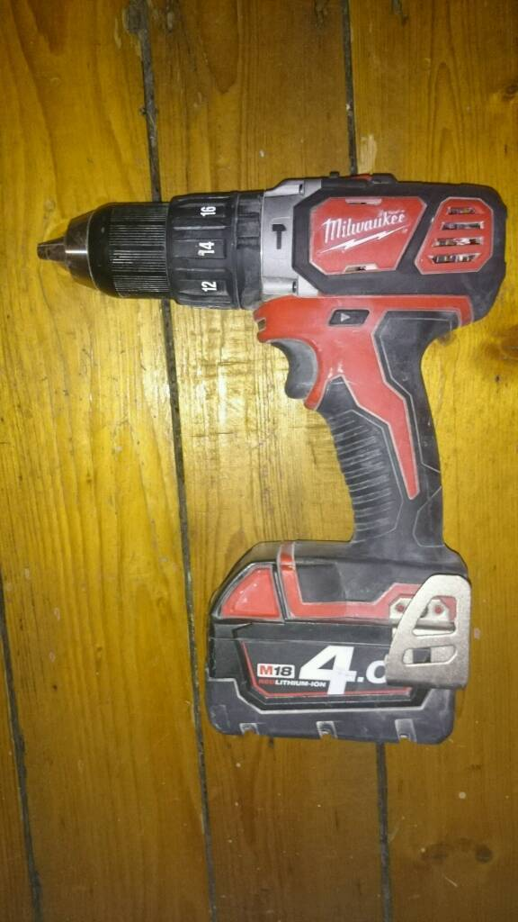 Milwaukee combi drill and 4amp battery