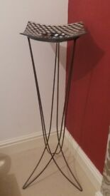 Retro metal stand with tiled plate