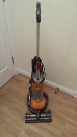 DC24 Dyson upright bagless hoover.