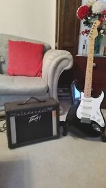 Fender Squier guitar and Peavey Audition Chorus Amplifier