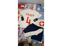 England football kit age 6-7. The name Paddy printed on the back. (Bought as a present wrong size)