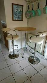 Tall Bar Table With cream leather Adjustable height stools/chairs