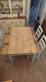 A beautiful solid pine shabby chic country style dining table and chairs