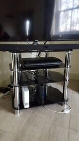 Tv stand, 4 black glass shelves.