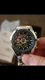Brand new winner fashion auto mechanical stainless steel men's watch (Comes in box and packaged)