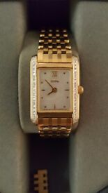 Beautiful Slimline with real diamonds. Wonderful gift for your someone special. Hardly worn. Perfect