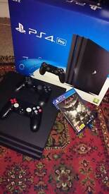 Ps4 pro mint condition 2 controllers 1 game