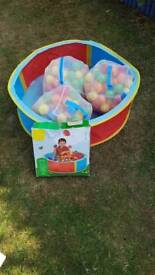 Small round ball pit and three bags of balls