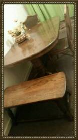 Antique table with bench and 3 chairs .