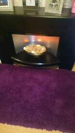 Black surround and electric fire