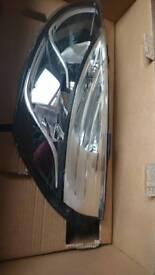 2013 Renault Clio halogen front head lamp.