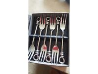 Culinery concept 6 fish forks