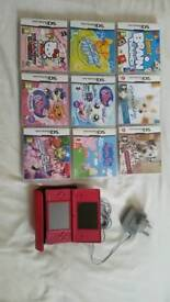Nintendo DSI in pink with 9 games and charger