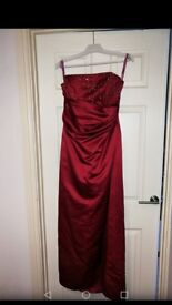 Stunning full length strapless red dress with beaded detail on bust