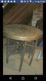 Copper and carved wood coffee table