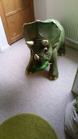 Playschool sit on moving dinosaur