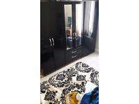 Black gloss wardrobe