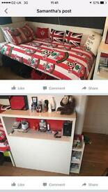 Single bed with storage shelves