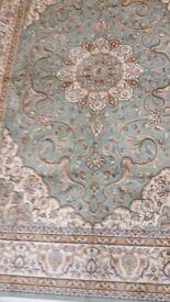 Green ground Persian machine woven Kashan style carpet, 2.3m x 1.6m