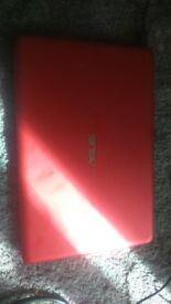 Red Asus laptop used about 10 times not needed. In great working condition. Light weight too.