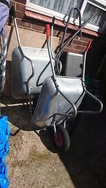 Wheelbarrows Large. New one and Smaller one used for plastering