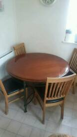 Round dining table and oak chairs