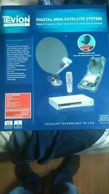 Caravan satellite dish and tuner