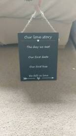 A4 hanging 'our love story'
