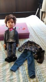 Excellent condition. Josh doll with full wedding outfit and casual outfit.