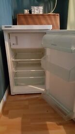 Free standing fridge with small freezer