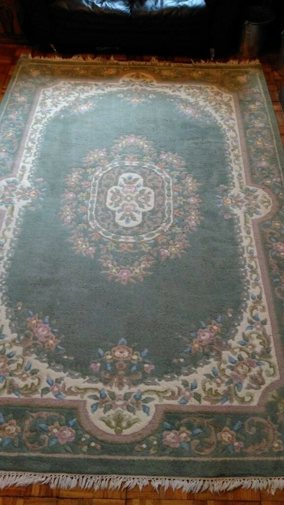 Decorative, very large pale green rug